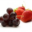 Black grape and red strawberry — Stock Photo #29296755