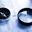 Stock Photo: Operating budget, magnifying glass and black compass