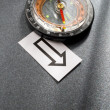 Stock Photo: Compass and cards on the grey background