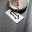 Compass and cards on the grey background — Stock Photo