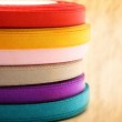 Reels of ribbon on stained paper background — Stock Photo #29962423