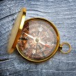 Compass on gray wooden background — Stock Photo