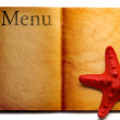Stock Photo: Open menu book and red seastar