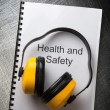 Health and safety register with earphones — Stock Photo #29962573