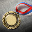 Blank medal on steel scratchy background — Stock Photo #29962579
