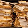 Stock Photo: Paper documents stacked in archive