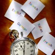 Cards with different languages and stopwatch — Stock Photo #29962589