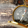 Compass on cracked wooden background — Stock Photo