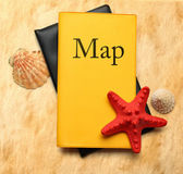 Seastar and seashells with map on stained paper — Stock Photo