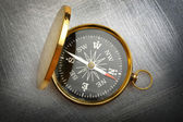 Compass on steel scratchy background — 图库照片