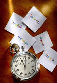 Cards with different languages and stopwatch — Stock Photo