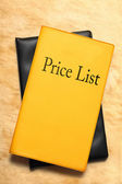 Price list book on stained paper — Stock Photo