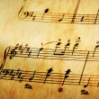 Stock Photo: Music notes in yellow toning