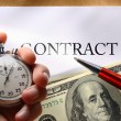 Contract with money and pen — Stockfoto