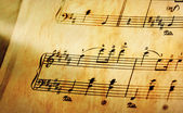 Music notes in yellow toning — Stock Photo