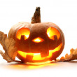 Funny halloween pumpkin with oak leaves — Stock Photo