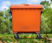 Orange garbage bin — Stock Photo