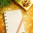 Stock Photo: Christmas background with notepad