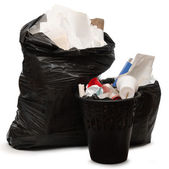 Full wastebasket and plastic bag — Stock Photo