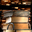 Stock Photo: Pile of old books and keylock