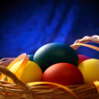 Easter eggs with yellow ribbon — Stock Photo