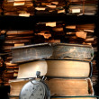 Stock Photo: Pile of old books and stopwatch