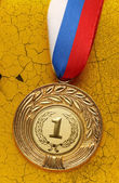 Medal on old wall — Stock Photo