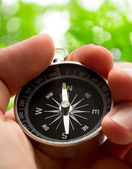 Hand holding compass — Photo