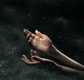 Female hands on stormy sky — Stock Photo