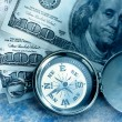 Stock Photo: Vintage compass and money