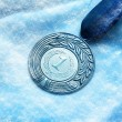 Medal on snow — Stock Photo