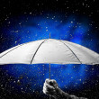 Stock Photo: Umbrellunder raindrops