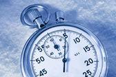 Cronômetro na neve — Fotografia Stock