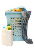 Washing basket with detergent — Stock Photo