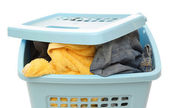 Plastic basket with clothes — Stock Photo