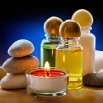 Spa stones, candle and shampoo — Stock Photo