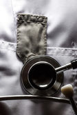 Stethoscope on medical coat — Stock Photo