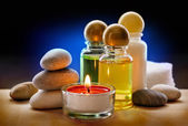 Spa stones, candle and shampoo — Stockfoto