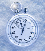 Stopwatch on snow — Stock Photo