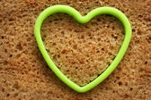 Bread slice and heart — Stock Photo