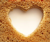 Slice of bread and heart — Stock Photo
