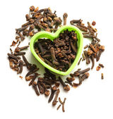 Cloves seeds in heart form — Stock Photo