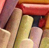 Pastel chalks in heap — Stock Photo
