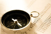 Operating budget and black compass — Stock Photo