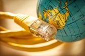 Ethernet cable and globe — Stock Photo