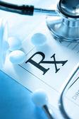 Stethoscope and pills — Stock Photo