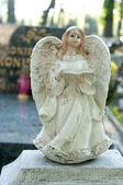 Angel figurine reading book. — Stock Photo