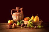 Ceramic jug and fruits — Stock Photo