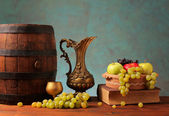 Old wooden barrel and fruits — Stock Photo