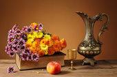 Flowers and a metal jug — Stock Photo